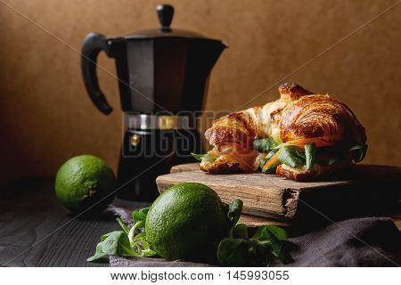 French Food For Breakfast. Baked Croissant Sandwich With Salmon