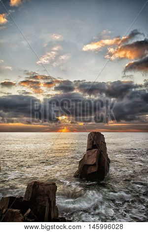 Mysteries of dawn. Sea sunrise at the Black Sea coast near Sozopol Bulgaria. Mysteries of dawn. Sea and Rocks seascape.