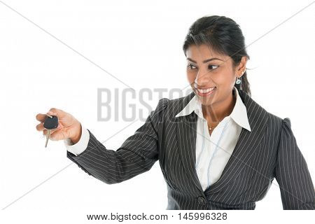 Indian car dealer hand over vehicle key to client, isolated on white background.