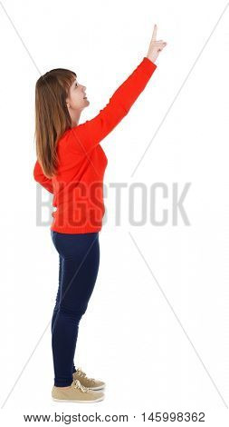 Back view of pointing woman. beautiful girl. girl in the red sweater is left side by pressing the index finger on the top button.