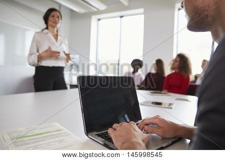 Close Up Of Student Using Laptop In Lecture