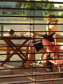 foto of stripping women window  - view through blinds - JPG