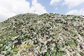 Постер, плакат: Glass Waste In Recycling Facility Pile Of Bottles