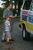pic of ice-cream truck  - a father and son buy dessert from an ice cream truck - JPG