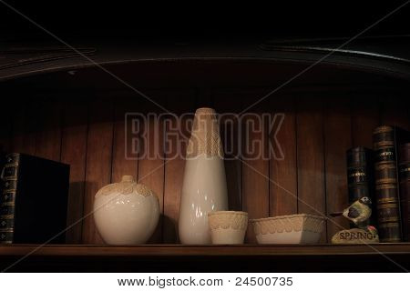 Books And Vase On A Shelf