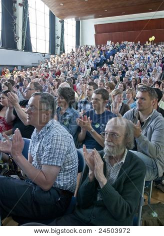 The audience applauds the speech by Bredan Barber at the strikers rally at Exeter Corn Exchange.