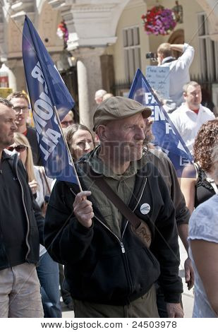 Protesters waver flags at the strikers march through Exeter City Centre.