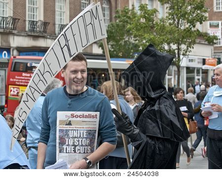 The Grim Reaper shares a joke with an Exeter Anti-Cuts Alliance campaigner during the Protest agains