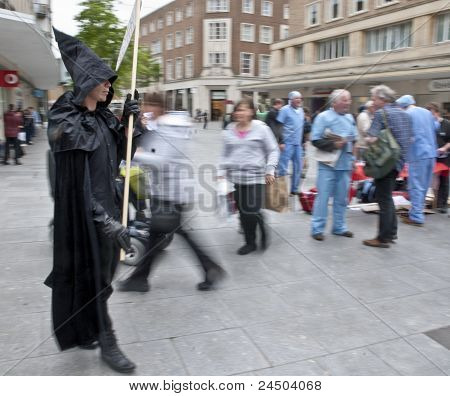 The Grim Reaper prowls the streets of Exeter during the Protest against NHS reforms.