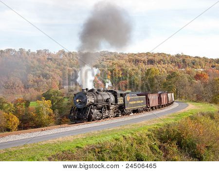 Wm Steam Train Powers Along Railway