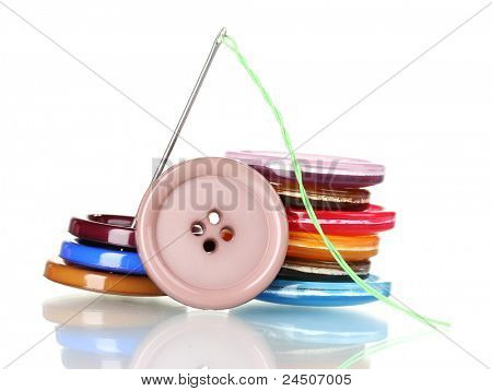 Bright sewing buttons and needle with thread isolated on white