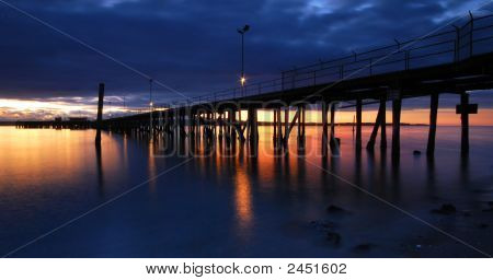 Sunset And A Pier