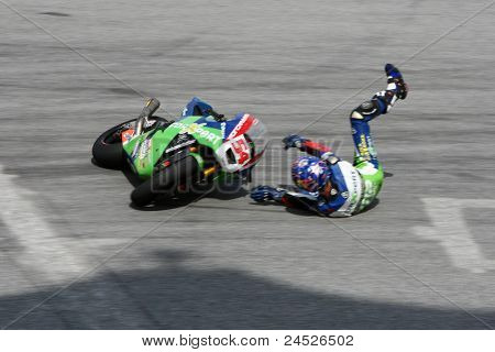 SEPANG, MALAYSIA - OCTOBER 21: Moto2 rider Kenan Sofuoglu falls at turn 15 during free practice at the Shell Advance Malaysian Motorcycle GP 2011 on October 21, 2011 at Sepang, Malaysia.