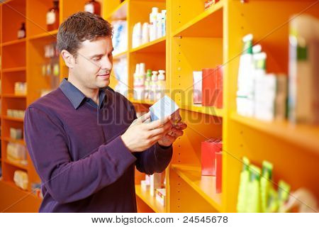 Man Checking Products In Pharmacy