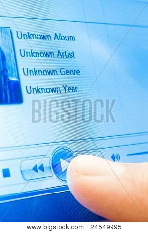 playing music on touchscreen device closeup