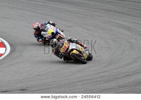 SEPANG, MALAYSIA - OCTOBER 22: Moto2 rider Mika Kallio (36) competes with other riders at qualifying race of the Shell Advance Malaysian Motorcycle GP 2011 on October 22, 2011 at Sepang, Malaysia.