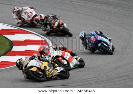 SEPANG, MALAYSIA - OCTOBER 22: Moto2 rider Stefan Bradl (65) competes with other riders at qualifying race of the Shell Advance Malaysian Motorcycle GP 2011 on October 22, 2011 at Sepang, Malaysia.