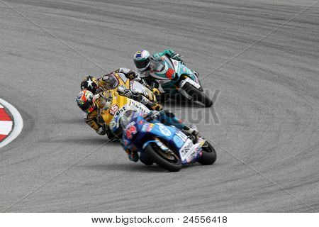 SEPANG, MALAYSIA - OCTOBER 22: Moto2 rider Alex de Angelis (15) competes with other riders at qualifying race of the Shell Advance Malaysian Motorcycle GP 2011 on October 22, 2011 at Sepang, Malaysia.