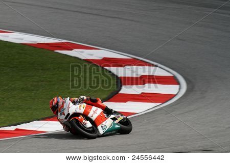 SEPANG, MALAYSIA - OCTOBER 22: Moto2 rider Stefan Bradl takes turn 1 during the qualifying race of the Shell Advance Malaysian Motorcycle GP 2011 on October 22, 2011 at Sepang, Malaysia.