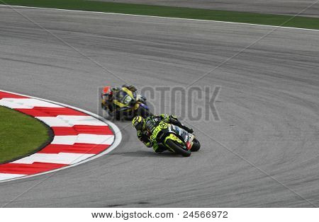 SEPANG, MALAYSIA - OCTOBER 22: Moto2 rider Andrea Iannone (29) takes turn 1 at the qualifying race of the Shell Advance Malaysian Motorcycle GP 2011 on October 22, 2011 at Sepang, Malaysia.