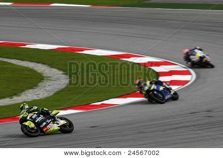 SEPANG, MALAYSIA - OCTOBER 22: Moto2 rider Andrea Iannone (29) leads other riders at the qualifying race of the Shell Advance Malaysian Motorcycle GP 2011 on October 22, 2011 at Sepang, Malaysia.