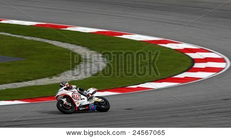 SEPANG, MALAYSIA - OCTOBER 22: Moto2 rider Yuki Takahashi competes at the qualifying race of the Shell Advance Malaysian Motorcycle Grand Prix 2011 on October 22, 2011 at Sepang, Malaysia.
