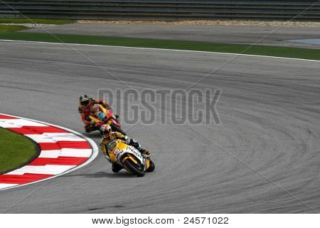 SEPANG, MALAYSIA- OCTOBER 22: Moto2 rider Alex deAngelis (15) races with another rider at the qualifying race of the Shell Advance Malaysian Motorcycle GP 2011 on October 22, 2011 at Sepang, Malaysia.