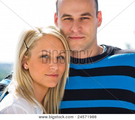 Attractive young couple portrait outdoors