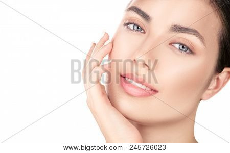 poster of Beautiful Spa Brunette girl Touching her Face. Perfect Fresh Skin. Beauty Portrait. Pure Beauty Mode