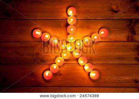 christmas candles pentagram star on golden warm wood