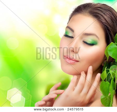 Beautiful Girl outdoors applying the natural cosmetics. Perfect fresh skin