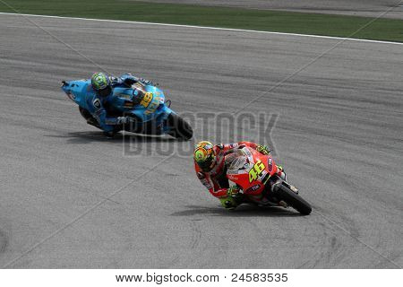 SEPANG, MALAYSIA - OCTOBER 22: MotoGP rider Valentino Rossi (46) and Alvaro Bautista compete at the Shell Advance Malaysian Motorcycle GP 2011 qualifying rounds on October 22, 2011 at Sepang, Malaysia