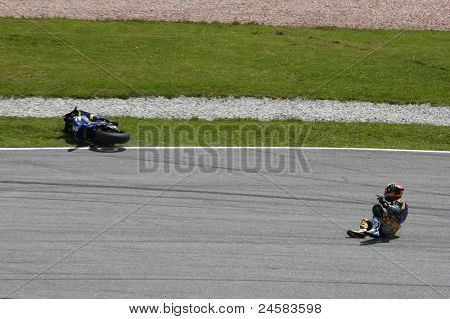 SEPANG, MALAYSIA - OCTOBER 23: Moto2 rider Mike di Meglio falls at turn 15 during warm-up at the Shell Advance Malaysian Motorcycle Grand Prix 2011 on October 23, 2011 at Sepang, Malaysia.
