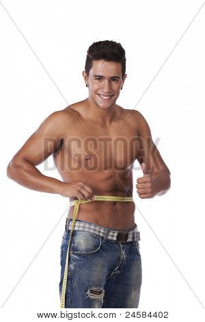 Men with perfect abs measuring his waist