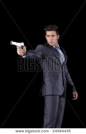 Poderoso empresário com uma arma (isolada em preto)