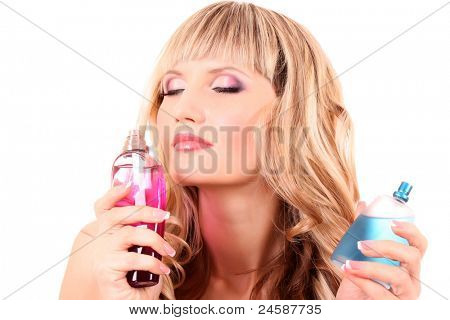 Young beautiful blonde  woman with bottle of perfume isolated on white background