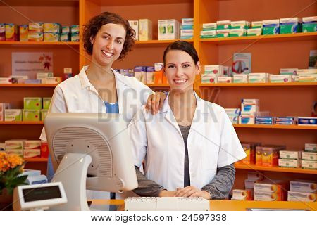 Pharmacist And Pharmacy Technician In Drugstore