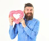 Macho In Love, Shows His Romantic Feelings. Man With Happy Face Holds Pink Heart, Symbol Of Love. Ma poster
