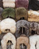 Natural Fur Hats. Handmade Wool Fur Headdress Shop Bazaar In Bukhara, Uzbekistan. Selling Group Of D poster