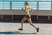 Pretty Sporty Woman Jogging At City At Morning. Fit Fitness Young Caucasian Girl Running. Female Spo poster
