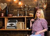 Girl Sits And Relaxing In House Of Gamekeeper. Girl In Casual Outfit Sits In Wooden Vintage Interior poster