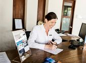 Receptionist working at the front desk poster