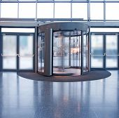 picture of revolver  - Revolving door in reception of office building - JPG