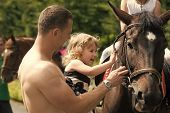 Happy Childhood, Fathers Day. Child With Muscular Macho Smile To Animal. Girl With Man Pet Horse On  poster