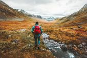 Traveling Man Tourist With Backpack Hiking In Mountains Landscape Active Healthy Lifestyle Adventure poster