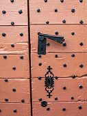The Old Pinkish Painted Door Of St. Peters Church In Beho, Belgium, Detail poster