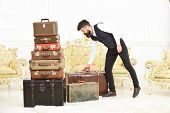 Macho Elegant On Strict Face Carries Vintage Suitcase. Man, Butler With Beard And Mustache Wearing C poster