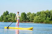 Adult Woman Is Floating On A Sup Board On Sunny Morning. Stand Up Paddle Boarding - Awesome Active R poster