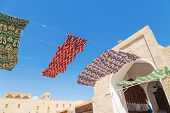Waving In Sky Fabric. Multicolored Silk Textile Materials Fluttering Against The Blue Sky. Garland O poster