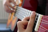 A Musician Plays A Solo Guitar, Man Playing Guitar Guitar Playing Close Fingers And Strings. poster